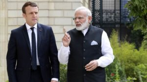 French President Emmanuel Macron, left, speaks with Indian Prime Minister Narendra Modi, in the gardens of the Elysee Palace in Paris, France, Saturday, June 3, 2017. Macron and the prime minister of India put forth a common front on the need to fight climate change on Saturday, with the French leader saying he would travel to India before year's end for a summit on promoting solar energy. (Jacques Demarthon, Pool Photo via AP)